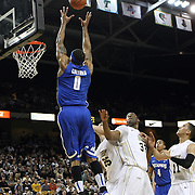 Memphis forward Will Coleman (0) leaps for a pass over Central Florida forward Keith Clanton (33)  during a Conference USA NCAA basketball game between the Memphis Tigers and the Central Florida Knights at the UCF Arena on February 9, 2011 in Orlando, Florida. Memphis won the game 63-62. (AP Photo: Alex Menendez)
