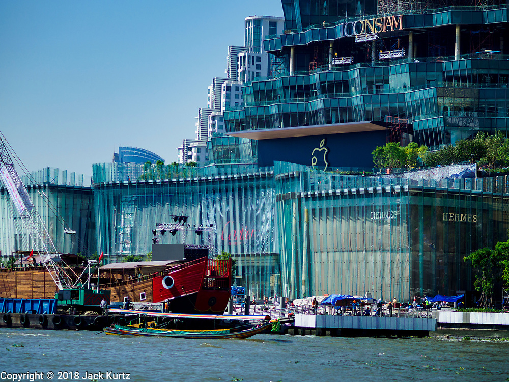 02 NOVEMBER 2018 - BANGKOK, THAILAND: The ICONSIAM development as seen from the Chao Phraya River in Bangkok. ICONSIAM is supposed to open November 9, the new Apple Store logo is in the middle of the frame. The logo is a blend of the traditional Apple logo and the Thai word for apple. ICONSIAM is a mixed-use development on the Thonburi side of the Chao Phraya River. It will include two large malls, with more than 520,000 square meters of retail space, an amusement park, two residential towers and a riverside park. It is the first large scale high end development on the Thonburi side of the river and will feature the first Apple Store in Thailand and the first Takashimaya department store in Thailand.    PHOTO BY JACK KURTZ