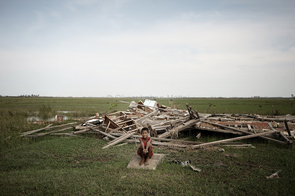 A young boy sits in front of the wreckage of his school in the village of Chaung Lin on May 23, 2008 in the isolated area of Kanzeik in the Irrawaddy Delta region -- an area only accessible by boat which has received neither government nor foreign aid. Voters in regions devastated by the cyclone, many hungry and destitute, cast ballots on May 24 in a referendum that many said was meaningless because Myanmar's junta has already declared victory.