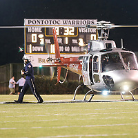 Lauren Wood | Buy at photos.djournal.com<br /> The helicopter pilot with Hospital Wings and Air Medical Services of Oxford delivers the game ball after landing at midfield before the start of Friday night's game at Pontotoc.