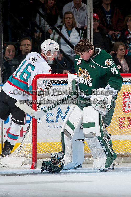KELOWNA, CANADA - JANUARY 08: Carter Hart #70 of Everett Silvertips loses his helmet during a save on a shot by Kole Lind #16 of Kelowna Rockets on January 8, 2016 at Prospera Place in Kelowna, British Columbia, Canada.  (Photo by Marissa Baecker/Shoot the Breeze)  *** Local Caption *** Carter Hart; Kole Lind;