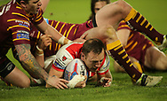 James Roby of St Helens scores his teams 2nd try of the game against Huddersfield Giants during the Betfred Super League match at the John Smiths Stadium, Huddersfield<br /> Picture by Stephen Gaunt/Focus Images Ltd +447904 833202<br /> 23/02/2018