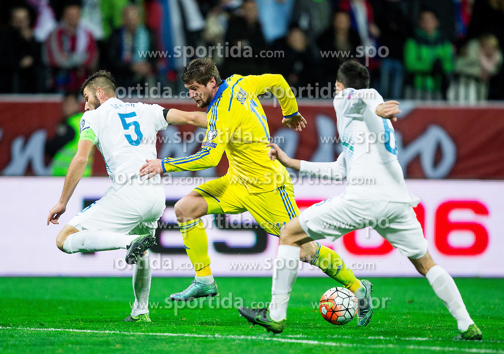 Serhiy Sydorchuk (UKR) between Bostjan Cesar (SLO) and Branko Ilic (SLO) during the UEFA EURO 2016 Play-off for Final Tournament, Second leg between Slovenia and Ukraine, on November 17, 2015 in Stadium Ljudski vrt, Maribor, Slovenia. Photo by Vid Ponikvar / Sportida