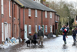 Residents  struggle through a flooded street in the village of Bridge, Kent , United Kingdom. Sunday, 9th February 2014. Picture by Stephen Lock / i-Images