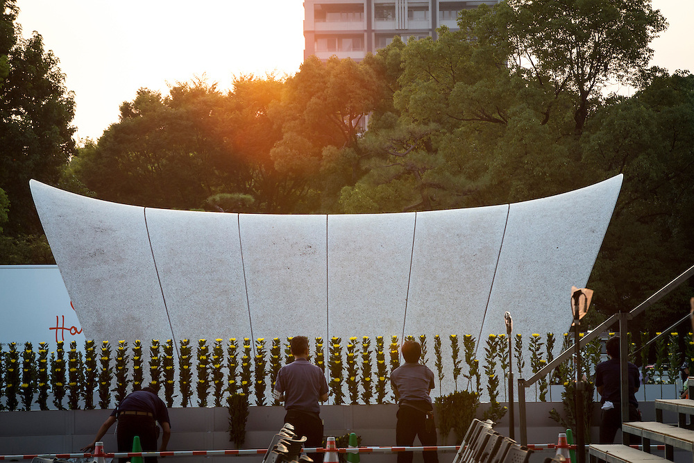 "HIROSHIMA, JAPAN - AUGUST 5 : People put flowers as they prepares the cenotaph for tomorrow's 71st anniversary of the atomic bombing on Hiroshima at Hiroshima Peace Memorial Park in Hiroshima, western Japan, Friday afternoon, August 5, 2016. Japan marked the 71st anniversary of the atomic bombing on Hiroshima. On August 6, 1945, during World War II, the United States dropped a uranium gun-type atomic bomb named ""Little Boy"" on the city of Hiroshima which instantly killed an estimated 80,000 people, tens of thousands more would later die of radiation exposure. Three days later, a second American B-29 bomber dropped a plutonium implosion-type bomb ""Fat Man"" on Nagasaki, killing an estimated 40,000 people.  (Photo: Richard Atrero de Guzman/NURPhoto)"