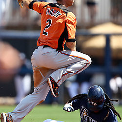 March 20, 2011; Port Charlotte, FL, USA; Baltimore Orioles shortstop J.J. Hardy (2) leaps over Tampa Bay Rays left fielder Manny Ramirez (24) after getting a force out at second base during a spring training exhibition game at Charlotte Sports Park.  Mandatory Credit: Derick E. Hingle-US PRESSWIRE