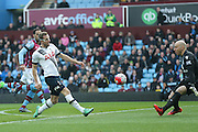 Tottenham Hotspur forward Harry Kane (10)  gets clear and chips Aston Villa goalkeeper Brad Guzan (1) but it goes over during the Barclays Premier League match between Aston Villa and Tottenham Hotspur at Villa Park, Birmingham, England on 13 March 2016. Photo by Simon Davies.