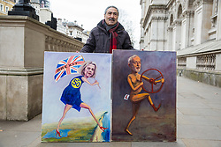 London, UK. 15th January, 2019. Satirical artist Kaya Mar stands outside Downing Street with paintings of Prime Minister Theresa May and Leader of the Opposition Jeremy Corbyn on the day of the vote in the House of Commons on Prime Minister Theresa May's proposed final Brexit withdrawal agreement.