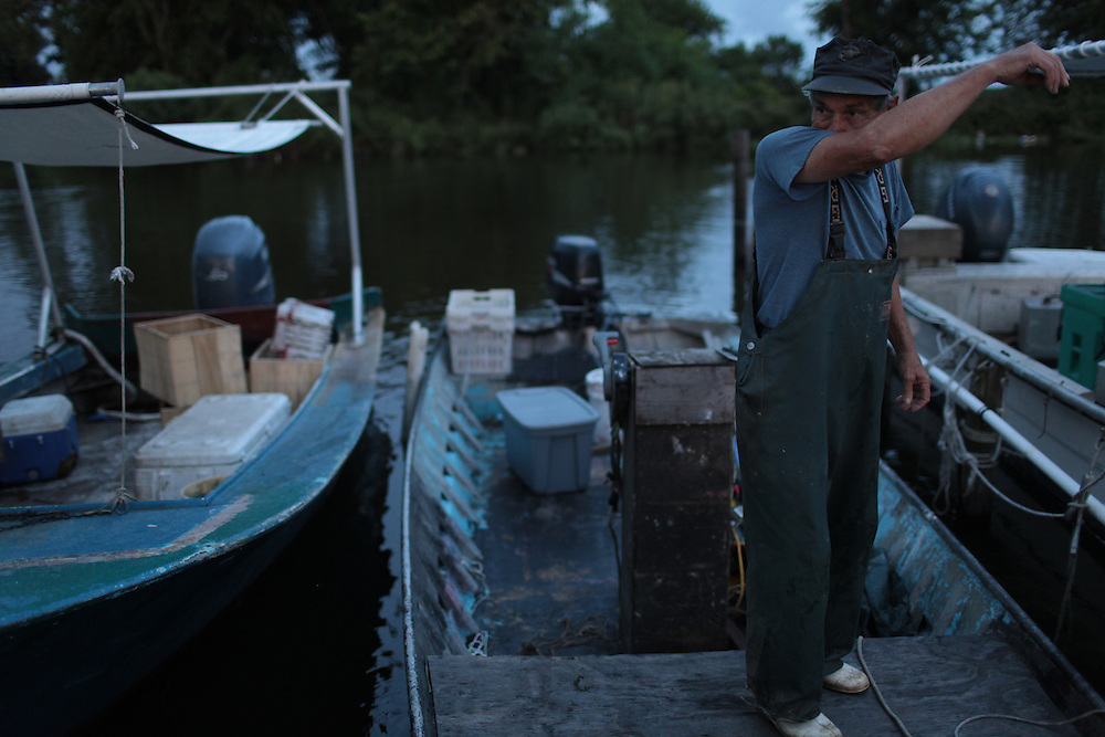 Thomas Gonzales, 72, getting ready to go gator hunting from Delacroix Island, LA August 31, 2010.  Last week he finished crabbing because the price dropped to $1.25 for the 1's and it wasn't worth the bait and gas to continue. Thomas is one of the only Delacroix fishermen not working for BP.