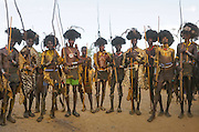 The Time for Knives in Ethiopia<br /> <br /> The Dassanech live in southern Ethiopia. Dwelling in isolation along the Omo River, they have retained an ancestral way of life.<br /> They are called the &ldquo;People from the Delta&rdquo; in relation to the neighboring Turkana Lake but their world is actually one of desert, dust and acacia trees. Add to this hostile environment the rampant presence of malaria. The Dassanech encompass eight clans. Each possesses magical powers, such as making fire, keeping snakes away or making it rain...<br /> <br /> <br /> The entire lives of the Dassanech revolve around their cattle, their only wealth. It provides meat, milk &ndash; which is essential during times of drought &ndash; and skins used as clothing and sleeping mats. The number of cows indicates their owner&rsquo;s social status. Despite their isolation, the Dassanech do not live in peace &ndash; their livestock remain under the threat of constant raids by the neighbouring tribes.<br /> <br /> And that is not folklore meant to impress the rare tourists who venture into these areas. Bloody clashes take place regularly, often with the Turkana tribe. Civil war is raging in southern Sudan nearby and Kalashnikovs sell for only $50. One only needs to take a look at the number of men with scars on their torsos, a sign that they have killed an enemy, to understand the ferocity of the fighting. There are hundreds of deaths every year. Kill a man and you will be a hero among the Dassanech.<br /> <br /> To become a man, one must go through the ceremony of the Dime. It takes place every year in June. It is the most important ritual in the lives of young Dassanech. This is the time for circumcision for boys and excision for girls. The time for knives, as the elders say.<br /> <br /> Testimonies about this ceremony are rare and for a good reason: the elders are reluctant to let foreigners attend the Dime. Even the few educated local Dassanech guides who live in the village of Omorate always come up with a good excuse not to go there or pretend to ignore the right places or dates.<br />
