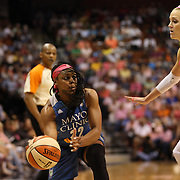 Monica Wright, (left), Minnesota Lynx, prepares to pass while defend by Katie Douglas, Connecticut Sun, during the Connecticut Sun Vs Minnesota Lynx, WNBA regular season game at Mohegan Sun Arena, Uncasville, Connecticut, USA. 27th July 2014. Photo Tim Clayton