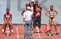 23-08-2015 CHN: IAAF World Championships Athletics day 2, Beijing<br /> Zonder een meter te lopen is de 100 meter op de WK atletiek in Peking alweer voorbij voor Jamile Samuel. De Amsterdamse sprintster maakte in de eerste ronde een valse start en kreeg de rode kaart. r-l Rebekka HAASE GER, Jamile SAMUEL NED en Nediam VARGAS.<br /> Photo by Ronald Hoogendoorn / Sportida