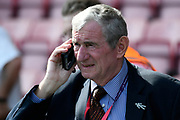David Pleat on the phone before the Premier League match between Bournemouth and Manchester City at the Vitality Stadium, Bournemouth, England on 26 August 2017. Photo by Graham Hunt.