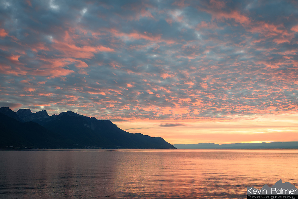 After a very cloudy day, the clouds broke just enough to allow for a colorful sunset over Lake Geneva near Veytaux.