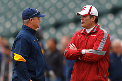 Nov 5, 2011; San Francisco CA, USA;  California Golden Bears head coach Jeff Tedford (left) talks to Washington State Cougars head coach Paul Wulff (right) before the game at AT&T Park.  Mandatory Credit: Jason O. Watson-US PRESSWIRE