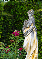 A stone statue of a woman in the Rose Garden at the Laskett Gardens, Much Birch, Herefordshire, UK