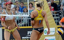 16-07-2014 NED: FIVB Grand Slam Beach Volleybal, Apeldoorn<br /> Poule fase groep G vrouwen - Laura Ludwig GER, Tanja Hüberli SUI