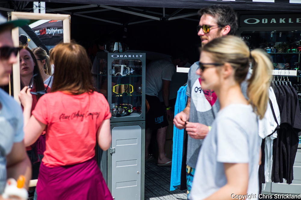 Nevis Range, Fort William, Scotland, UK. 4th June 2016. Crowds enjoy the trade stands, needless to say as the highland heatwave continues sunglasses are proving popular. The worlds leading mountain bikers descend on Fort William for the UCI World Cup on Nevis Range.