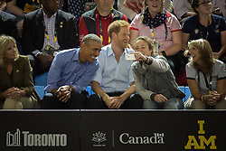 A fan takes a selfie with former U.S. President Barack Obama as he watches wheelchair basketball with Prince Harry at the Invictus Games in Toronto, ON, Canada, on Friday, September 29, 2017. Photo by Chris Donovan/CP/ABACAPRESS.COM