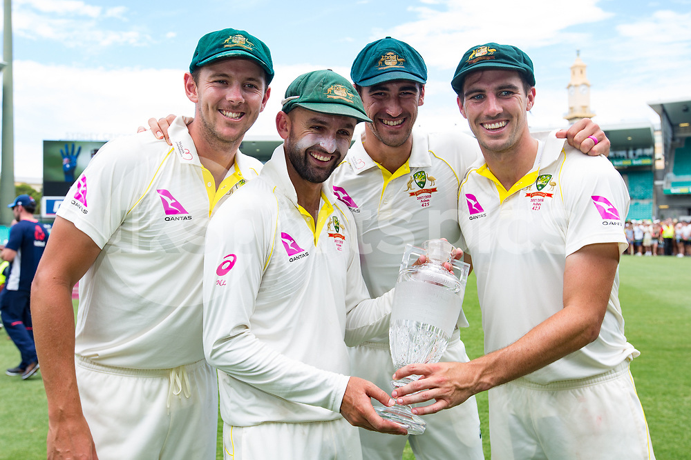 Josh Hazlewood Nathan Lyons Mitchell Stark and Pat Cummins of Australia after winning the Ashes during day 5 of the fifth test match during the 2017/18 Ashes Series between Australia and England at  Sydney Cricket Ground, Sydney, Australia on 8 January 2018. Photo by Peter Dovgan.