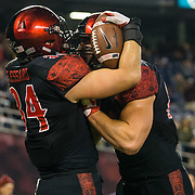 24 November 2018: San Diego State Aztecs fullback Isaac Lessard (34) is congratulated by tight end Kahale Warring (87) after scoring the game tying touchdown in the fourth quarter. The Aztecs closed out the season with a 31-30 overtime loss to Hawaii at SDCCU Stadium.