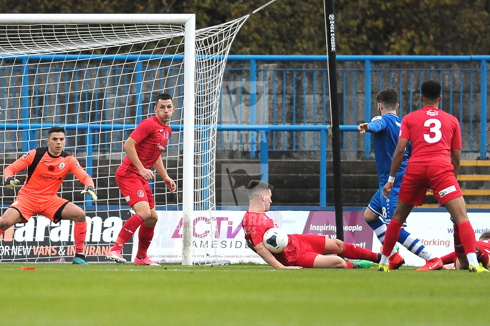 TELFORD COPYRIGHT MIKE SHERIDAN PENALTY. Sean Miller's shot is blocked by the arm of Ross White of Telford during the Vanarama National League Conference North fixture between Curzon Asthon and AFC Telford United on Saturday, November 9, 2019.<br /> <br /> Picture credit: Mike Sheridan/Ultrapress<br /> <br /> MS201920-028