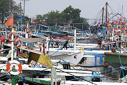 MANILA, Dec. 26, 2016  Fishermen secure fishing boats to avoid typhoon Nock-Ten at a port in Manila, the Philippines, Dec. 26, 2016. Several sea vessels were grounded in provinces due to the strong winds brought by typhoon Nock-Ten, packing maximum sustained winds of up to 185 kilometers per hour near the center and gusts of up to 255 kph.  Authorized by ytfs* (Credit Image: © Rouelle Umali/Xinhua via ZUMA Wire)