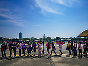 "13 JANUARY 2018 - BANGKOK, THAILAND:      People stand in line for a snack stand during Children's Day activities at the Royal Thai Army's King's Guard 2nd Cavalry Camp in central Bangkok. Children's Day is called ""Wan Dek"" in Thai. Many government offices and military bases hold special activities for children as do shopping malls.   PHOTO BY JACK KURTZ"