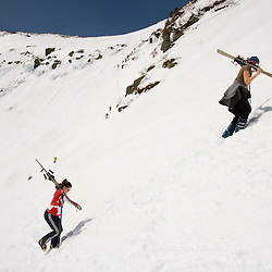 Skiers climbing Tuckerman Ravine in New Hampshire's White Mountains. White Mountain National Forest. April.