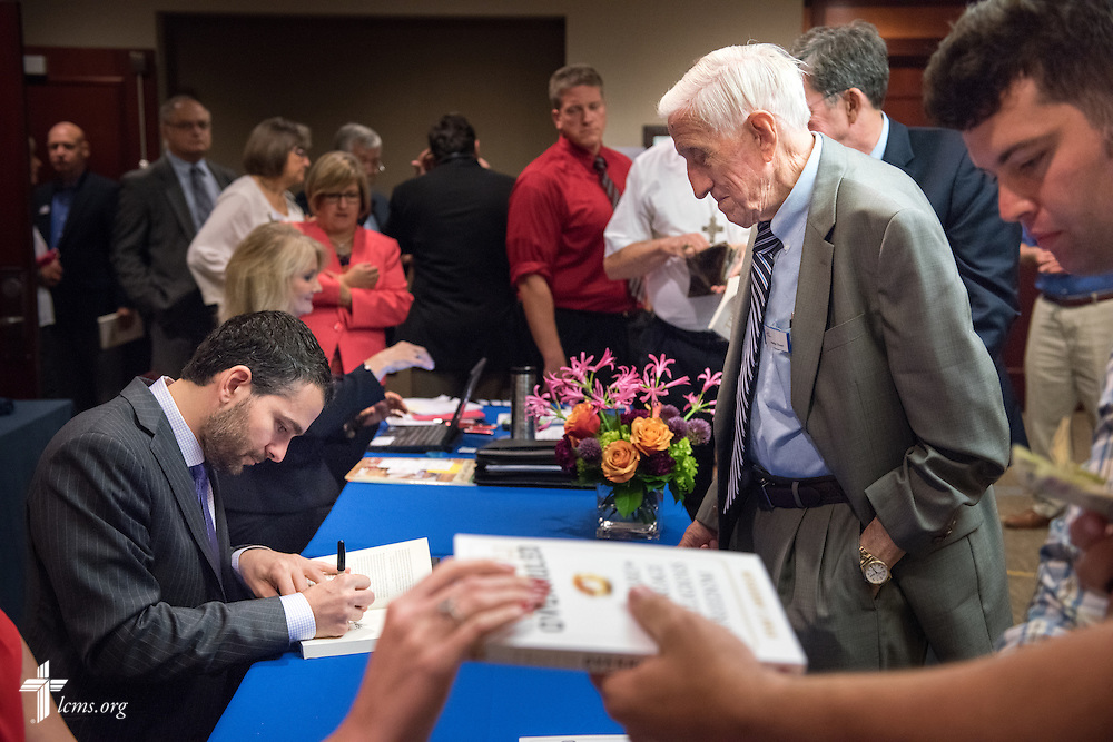 "Dr. Ryan Anderson, author of the book ""Truth Overruled: The Future of Marriage and Religious Liberty,"" signs books at the Let's Talk Life, Marriage and Religious Liberty event on Wednesday, Sept. 9, 2015, in Washington, D.C. LCMS Communications/Erik M. Lunsford"