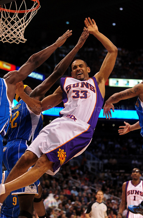 Mar. 14 2010; Phoenix, AZ, USA; Phoenix Suns forward Grant Hill (33) attempts to put up a shot in the second half against New Orleans Hornets' Emeka Okafor (50) and forward Julian Wright (32) at the US Airways Center. The Suns defeat the Hornets 120 to 106. Mandatory Credit: Jennifer Stewart-US PRESSWIRE.