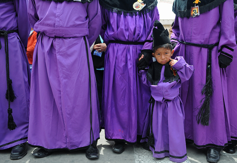 "Apr 22, 2011 - Quetzaltenago, Guatemala - Semana Santa or Holy Week continued in Quetzaltenago with the ""Procession to the Cathedral"" Resident of the second largest city in Guatemala lined the streets of the Procession route leading into the Central Park. A small boy accompanies other memebers of the Nazarene Brotherhood during the procession Friday Morning..(Credit Image: © Josh Bachman/ZUMA Press)"
