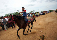 A Wayuu Indian boy rides a horse during a race that is part of the annual Wayuu Cultural Festival in Uribia, Colombia June 10, 2007. (Photo/Scott Dalton)