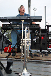 20 September 2014:   Jerry Abner.<br /> <br /> Marc Boon and the Unknown Legends perform at the Chris Brown Benefit Concert at the Corn Crib Stadium, Normal Illinois.  The band is comprised of 8 musicians: Marc Boon - front man and lead guitar, Jeff Young - drums, Ray Wiggs- keyboards, Aaron Garcia - trumpet-percussion-vocals, Burl Torner - guitar, Russell Zehr - saxaphone-guitar-keyboards-vocals, Chris Briggs - bass-vocals-keyboard, Jerry Abner - keyboards,