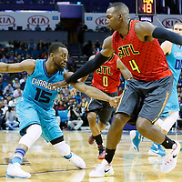 01 November 2015: Atlanta Hawks forward Paul Millsap (4) defends on Charlotte Hornets guard Kemba Walker (15) during the Atlanta Hawks 94-92 victory over the Charlotte Hornets, at the Time Warner Cable Arena, in Charlotte, North Carolina, USA.