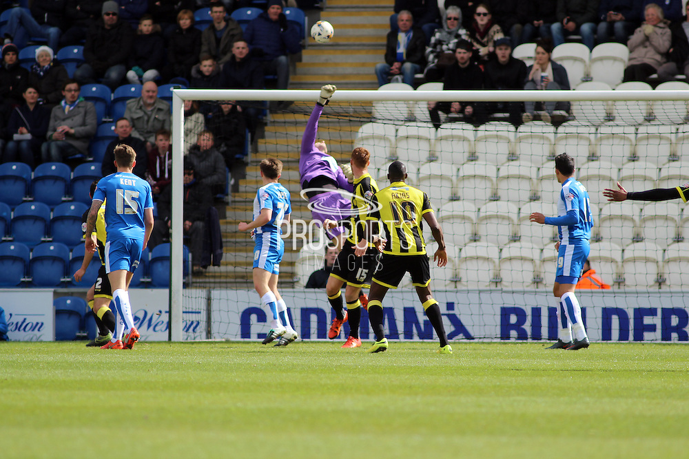 A save from Colchester goalkeeper Elliott Parish in the Sky Bet League 1 match between Colchester United and Burton Albion at the Weston Homes Community Stadium, Colchester, England on 23 April 2016. Photo by Nigel Cole.