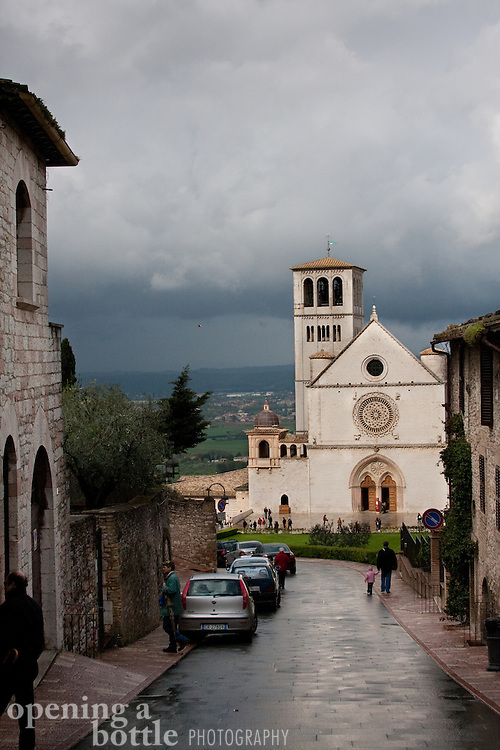 The Church of Saint Francis (Basilica di San Francesco) in Assisi, after a clearing storm, near Perugia, Umbria, Italy.