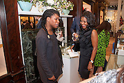 BEN BENJAMIN; RENI FOLAWIYO, Smythson Royal Wedding exhibition preview. Smythson together with Janice Blackburn has commisioned 5 artist designers to create their own interpretations of  Royal wedding memorabilia. Smythson. New Bond St. London. 5 April 2011.  -DO NOT ARCHIVE-© Copyright Photograph by Dafydd Jones. 248 Clapham Rd. London SW9 0PZ. Tel 0207 820 0771. www.dafjones.com.