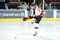 KELOWNA, CANADA, OCTOBER 11:  Matthew Konan #6 of the Medicine Hat Tigers takes a shot on net during warm-up as the Medicine Hat Tigers visited the Kelowna Rockets on October 11, 2011 at Prospera Place in Kelowna, British Columbia, Canada (Photo by Marissa Baecker/shootthebreeze.ca) *** Local Caption ***Matthew Konan;