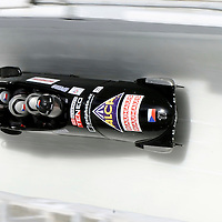 28 February 2007:    The Czech Republic bobsled driven by Ivo Danilevic with sidepushers Martin Bohmann and Roman Gomola, and brakeman Jan Stoklaska drive through turn 14 in the 1st run at the 4-Man World Championships competition on February 27 at the Olympic Sports Complex in Lake Placid, NY.