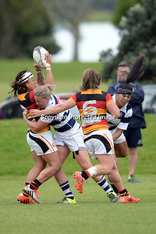 Waikato's Teresa Te Tamaki tackled by Auckland Storm's Lydia Crossman during the Women's Rugby NPC Semi Final, Auckland Storm v Waikato. Auckland, New Zealand on Saturday 10 October 2015. Copyright Photo: Raghavan Venugopal / www.photosport.nz