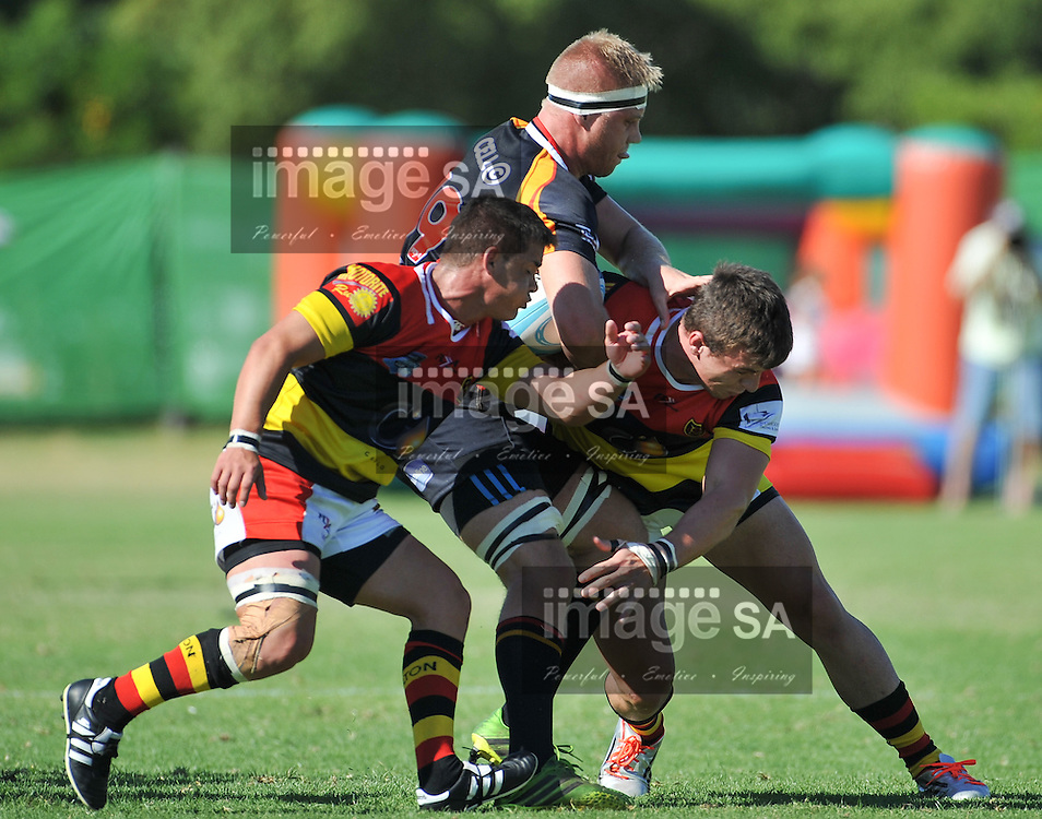 CAPE TOWN, SOUTH AFRICA - Saturday 28 February 2015, Cameron Smith of Vaseline Wanderers  is tackled by Ryno Rust and Francois Esterhuyzen of Hamiltons RFC during the second round match of the Cell C Community Cup between Hamiltons and Vaseline Wanderers at the Stephan Oval, Green Point.<br /> Photo by Roger Sedres/ImageSA/SARU