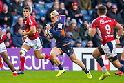 Darcy Graham (#14) of Edinburgh Rugby breaks through the SU Agen defence on his way to scoring his first try during the European Rugby Challenge Cup match between Edinburgh Rugby and SU Agen at BT Murrayfield, Edinburgh, Scotland on 18 January 2020.