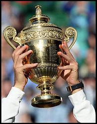 Image licensed to i-Images Picture Agency. 06/07/2014. London, United Kingdom. Novak Djokovic with the trophy  after winning the Wimbledon Men's Final.  Picture by Andrew Parsons / i-Images