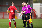 Joe McNerney, Defender with Crawley Town (5) thanking the Match Officials following the EFL Sky Bet League 2 match between Crawley Town and Scunthorpe United at The People's Pension Stadium, Crawley, England on 19 September 2020.
