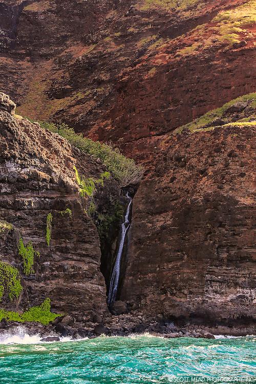 Waterfall on Na Pali Coast, Kauai, Hawaii