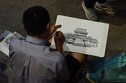 July 18, 2017 - Chongqin, Chongqin, China - Chongqing, CHINA-July 18 2017: (EDITORIAL USE ONLY. CHINA OUT) ..The 28-year-old wandering artist Luo Yunbo earns his life by selling his paintings on street in southwest China's Chongqing. Luo says that he finishes at least one painting every day and also does labor work. (Credit Image: © SIPA Asia via ZUMA Wire)