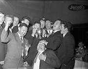 14/04/1962<br /> 04/14/1962<br /> 14 April 1962<br /> Jacob's Presentation.<br /> Cup being presented to winning team of the match between Jacob's Of Dublin and Jacob's of Liverpool at Jacobs Reception Hall, Dublin.