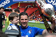 Yann Kermorgant celebrates with his son and the Sky Bet Championship trophy after the Sky Bet Championship match between Charlton Athletic and Bournemouth at The Valley, London, England on 2 May 2015. Photo by David Charbit.