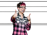 Portrait of a smiling young woman showing thumbs up sign in studio on white isolated background